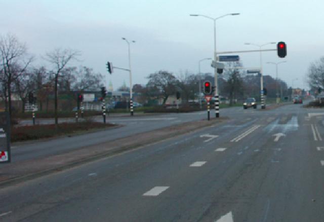 De verkeerslichten springen op rood. wat doe je?